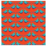 Blue bird with orange background pattern Royalty Free Stock Images