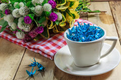 The blue bird paper in the cup and flower also red cloth on the Royalty Free Stock Image