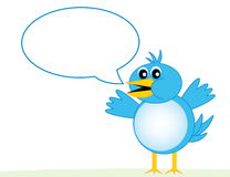 Blue Bird With Word Bubble. A cartoon blue bird with a text bubble, for posting a message in Stock Photo
