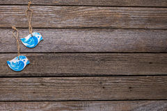 Blue birds on wooden background. Royalty Free Stock Images