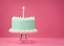 Blue Birthday Cake over pink Background. Royalty Free Stock Image