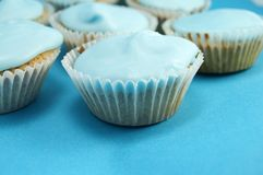 Blue birthday cakes. Front one in focus stock photography