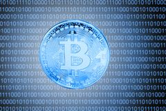Blue bitcoin over digital background. Crypto currency concept Stock Images