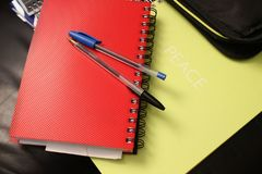 Blue and Black Ball Point Pens on Red Hand Book Royalty Free Stock Photo