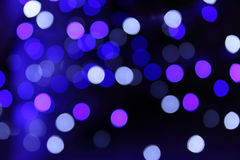 Blue and black bokeh blur illuminated background Stock Image
