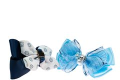 Blue and black bow hair bands on white isolated background royalty free stock photography