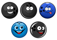 Blue and black bowling balls cartoon characters. Funny blue and black glossy bowling balls cartoon characters with happy faces suitable for team mascot design Stock Photography