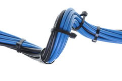 Blue and black electrical wires with cable ties Stock Image