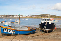 Blue and Black fishing boats at Conwy Harbour stock images