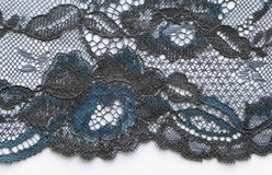 Blue and black flowers lace material texture macro shot Royalty Free Stock Photography