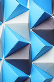 Blue, black and gay tetrahedrons. Royalty Free Stock Image