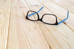 Blue and black glasses on wood table background.  stock photo