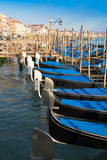 Blue and black gondolas on canal Royalty Free Stock Photo