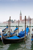 Blue and black gondolas on Grand canal Royalty Free Stock Image