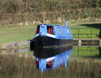 Blue and black narrow boat at Tewitfield on canal. Royalty Free Stock Images