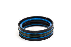 Blue and black oil seal isolated on white background Stock Images