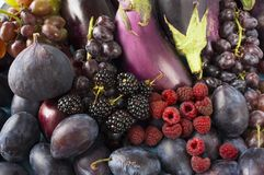 Blue-black and purple food.food. Background of berries, fruits and vegetables. Fresh blackberries, raspberries, figs, plums, eggplant and grapes. Top view royalty free stock image