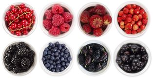 Blue-black and red fruits and berries isolated on white. Sweet and juicy berry with copy space for text. Top view. Mulberries, blu. Eberries, blackberries, black Royalty Free Stock Image
