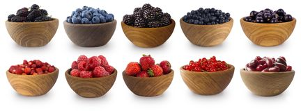 Blue-black and red fruits and berries solated on white. Sweet and juicy berry with copy space for text. Mulberries, blueberries, b Stock Photography