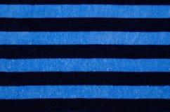 Fleece sweatshirt texture, background. Blue black striped fleece sweatshirt, dressing-gown, texture Royalty Free Stock Photo