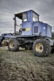 Blue and Black Tractor in Green Grass Royalty Free Stock Image