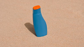 Blue blank bottle on the sand Royalty Free Stock Photography