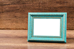 Blue blank photo frame on wooden room. Royalty Free Stock Photos