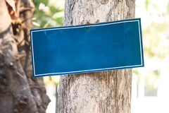 Blue blank sign hang on tree for message text. Blue empty black board for text and message Stock Photography