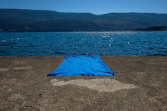 Blue blanket on concrete surface stock photography