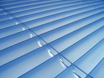 Blue Blinds. Window venitian plastic blinds in a shade of pastel blue stock photo