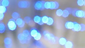 Blue blinking bokeh. The lights in the defocusing stock footage