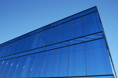 Blue block. A modern office block with blue glass facade thrusts into the sky Royalty Free Stock Photo
