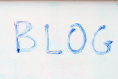 Blue blog on whiteboard. The word blog written on a whiteboard with an old blue marker Stock Photography