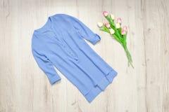 Blue blouse, bouquet of tulips. Fashionable concept.  stock photo