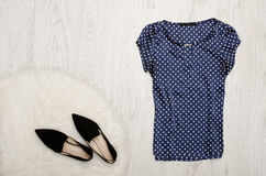 Blue blouse with polka dots, shoes on a wooden background. Fashi Royalty Free Stock Photos