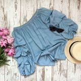Blue blouse on a wooden background stock image