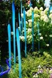 Blue blown glass  among hydrangeas Royalty Free Stock Photo
