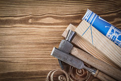 Blue blueprint claw hammer chisel wooden studs curled shavings o. N wood board royalty free stock image