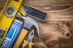 Blue blueprints construction level square ruler claw hammer plie Stock Images