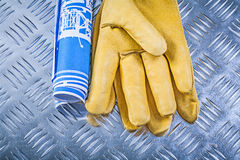 Blue blueprints leather safety gloves on fluted metal background Stock Photography