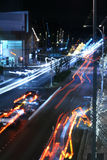 Blue Blur Boulevard. City boulevard illuminated and blurred by street lights and car lights stock images