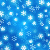 Blue blurred background with glowing snowflakes. Vector festive background. Abstract winter background Stock Photography