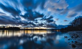 Blue Blurred Moving Clouds Over River Royalty Free Stock Photo