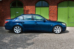 Blue BMW E60 545 i Royalty Free Stock Photos