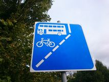 Blue board sign for bus and cycle lane. Blue board sign on a pole for bus and cycle lane outsdoors Royalty Free Stock Image