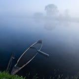 Blue boat 2. Early morning fog Stock Photos