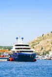 Blue boat. Summer big blue boat at sea royalty free stock photos