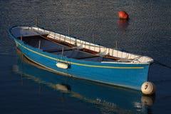 A blue boat at anchor. At morning light royalty free stock photos