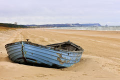 Blue boat on the beach Royalty Free Stock Photo