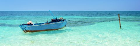 Blue boat, Cayo Levisa, Cuba. Blue boat on turquoise water, Cayo Levisa, Cuba Royalty Free Stock Photo